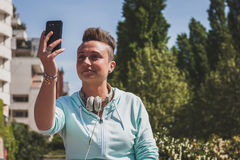 Portrait of a short hair girl taking a selfie Royalty Free Stock Images