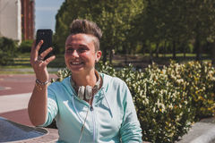 Portrait of a short hair girl taking a selfie Stock Image