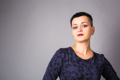 Portrait of short haired woman in blue dress.  royalty free stock photos