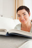 Portrait of a short-haired woman with a book Stock Photo