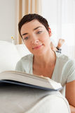 Portrait of a short-haired woman reading a book Stock Images