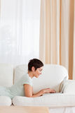 Portrait of a short-haired woman using a laptop Royalty Free Stock Image