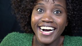 Portrait shot, african american woman shows on camera a joyful surprise. Slow motion shooting stock footage