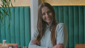 Portrait shot of attractive woman looking at the camera and smiling in the urban office. close up. stock video footage