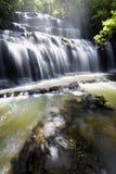 A portrait shot of beautiful cascaded waterfall. Royalty Free Stock Image