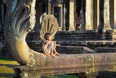 Portrait shot of a cambodian boy in Angkor Wat complex Stock Photos