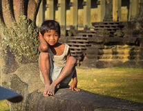 Portrait shot of a cambodian boy in Angkor Wat complex Stock Photography