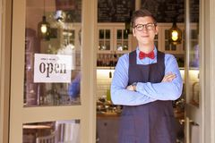 Free Portrait Shot Of Small Business Owner Young Man Standing In His Small Cafe With Arms Crossed Royalty Free Stock Image - 164849596