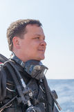 Portrait shot of a scuba diver from the side Royalty Free Stock Photography