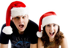 Portrait of shouting couple wearing christmas hat. On an isolated background Stock Image