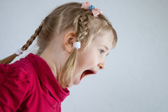Portrait of a shouting  little girl Stock Image