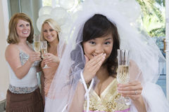 Portrait Of Shy Bride Holding Champagne Flute Royalty Free Stock Photos