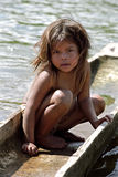 Portrait of shy Indian Girl, North Nicaragua. This native american child sits in a dugout canoe, canoes, hollowed-out tree trunk, the means of transport for this Stock Photos