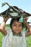 Portrait of shy Ixil Indian girl with school supplies. Guatemala, Retalhuleu Department, El Triumfo Village: In this refugee camp for Ixil Indians, this child is Stock Photo