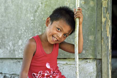 Portrait of shy laughing Filipino boy Stock Photos