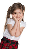 Portrait of a shy little girl. A portrait of a shy little girl on the white background stock images