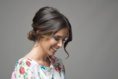 Portrait of shy timid smiling beautiful woman looking down expression Stock Photography
