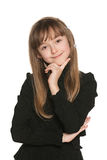 Shy young girl in black Stock Image