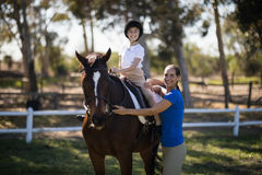 Portrait of sibling with horse. At paddock Royalty Free Stock Images