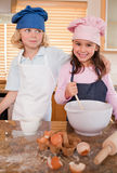 Portrait of siblings baking together Royalty Free Stock Images