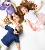 Portrait of siblings lying on a white background Royalty Free Stock Photo