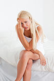 Portrait of a sick blonde woman Royalty Free Stock Image