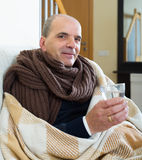 Portrait of sick elderly man. Being treated for cold at home Stock Photography