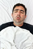 Portrait of a sick hispanic man coughing Stock Image