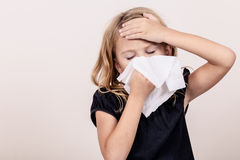 Portrait of a sick little girl Stock Photography