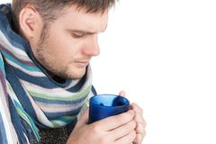 Portrait of sick man holding cup of tea. Royalty Free Stock Photo
