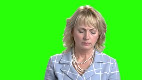 Portrait of sick woman with closed eyes. Close up portrait of upset mature woman with sore throat on Alpha Channel background. People and healthcare stock video footage