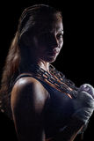 Portrait side view of female fighter holding chain Royalty Free Stock Images