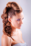 Portrait sideview of blonde girl in elegant whimsical coiffure Stock Images