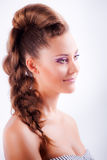 portrait sideview of blonde girl in elegant whimsical coiffure Royalty Free Stock Photography