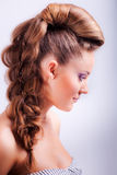 Portrait sideview of blonde girl in elegant whimsical coiffure Royalty Free Stock Photo