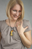 Portrait of sincere smiling blond woman Royalty Free Stock Image