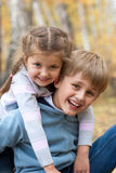 Portrait of sister and brother outdoors Royalty Free Stock Image