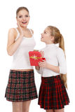 Portrait of sisters with a gift box Royalty Free Stock Photography