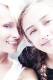 Portrait of sisters in sunny day. Royalty Free Stock Images