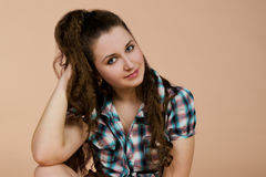 Portrait of sitting beautiful  brunette woman Royalty Free Stock Photos