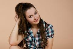 Portrait of sitting beautiful brunette woman royalty free stock photos
