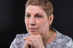 Portrait of sitting old woman looking side stock photos