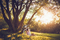 Portrait sitting under a tree with bicycle Stock Photos