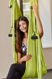 Portrait of sitting woman in anti-gravity aerial yoga Royalty Free Stock Photos