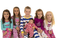 Portrait of six adorable children wearing winter pajamas Royalty Free Stock Image