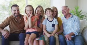 Portrait of six members of a multi-generation Caucasian family spending time at home together