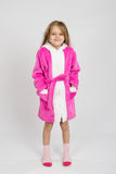 Portrait of a six-year growth girl in bathrobe Stock Image