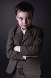 Portrait of six year old boy in gray  suit Stock Photos