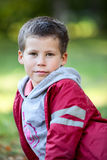 Portrait of a six year old Caucasian boy in red jacket Stock Photo