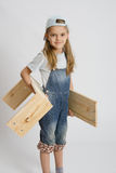 Portrait of a six year old girl with boards in hands Royalty Free Stock Photos